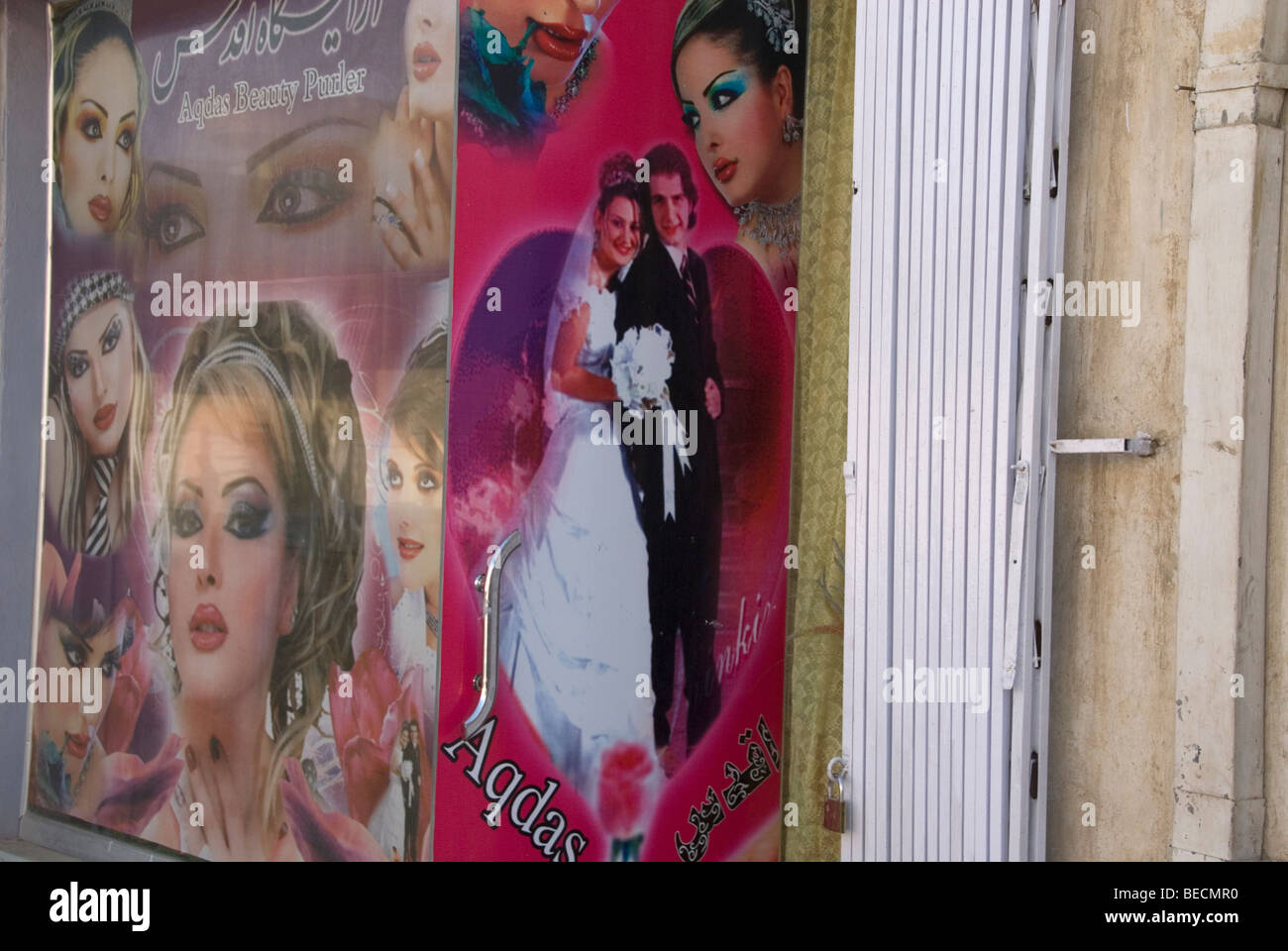 August 2009 Afghanistan. Kabul .Photos of attractive women with make-up outside a beauty salon - Stock Image