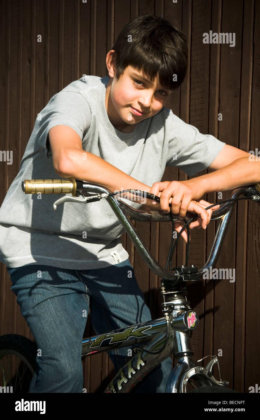 boy boys bike bmx on ride cycle cyclist cycling kid riding kids cool trendy  fashionable smile