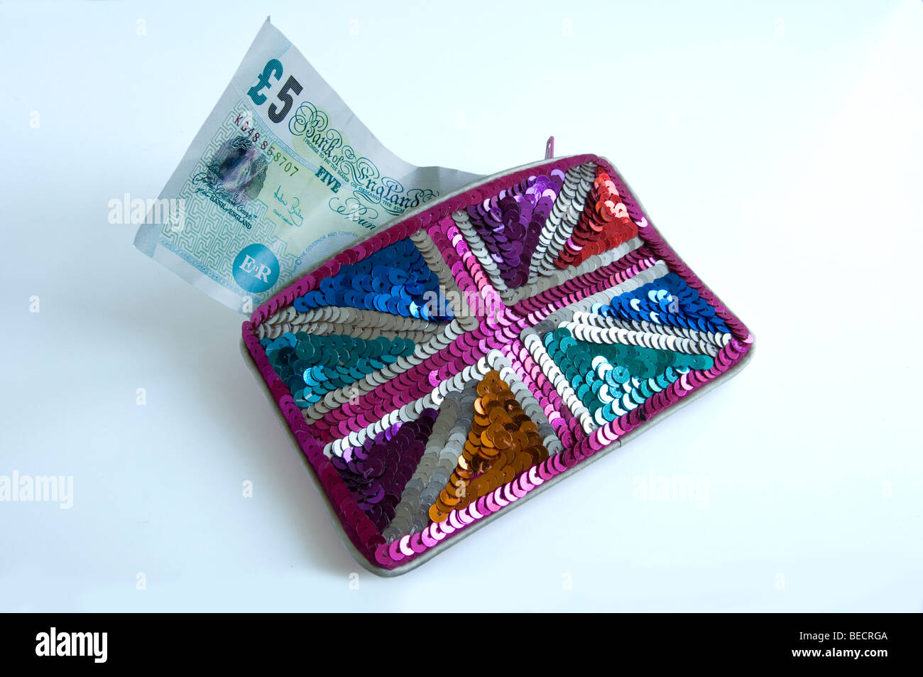 £5 note and sequin purse. - Stock Image