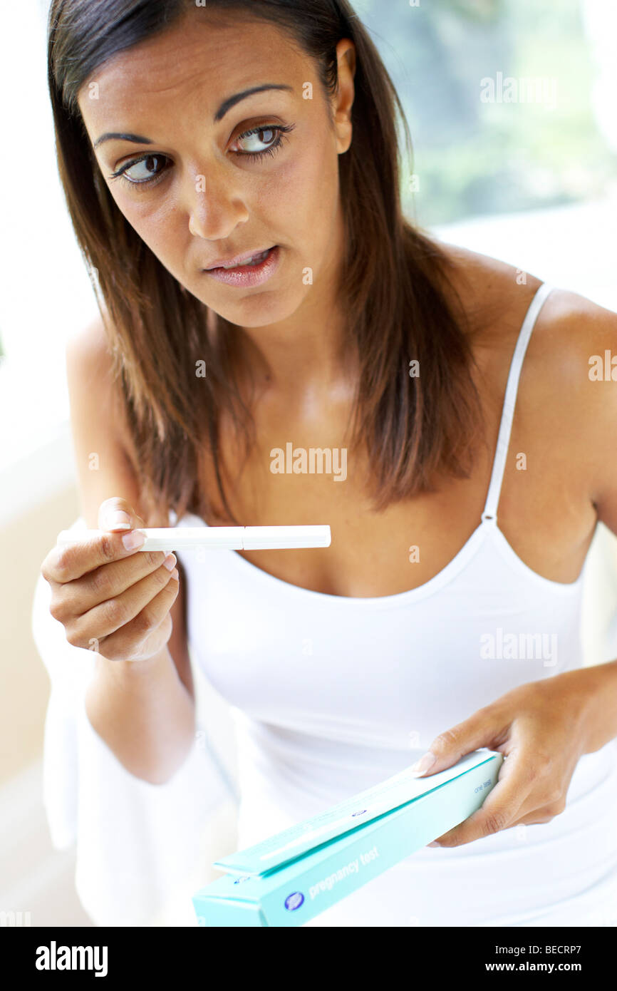 Girl with pregnancy test - Stock Image