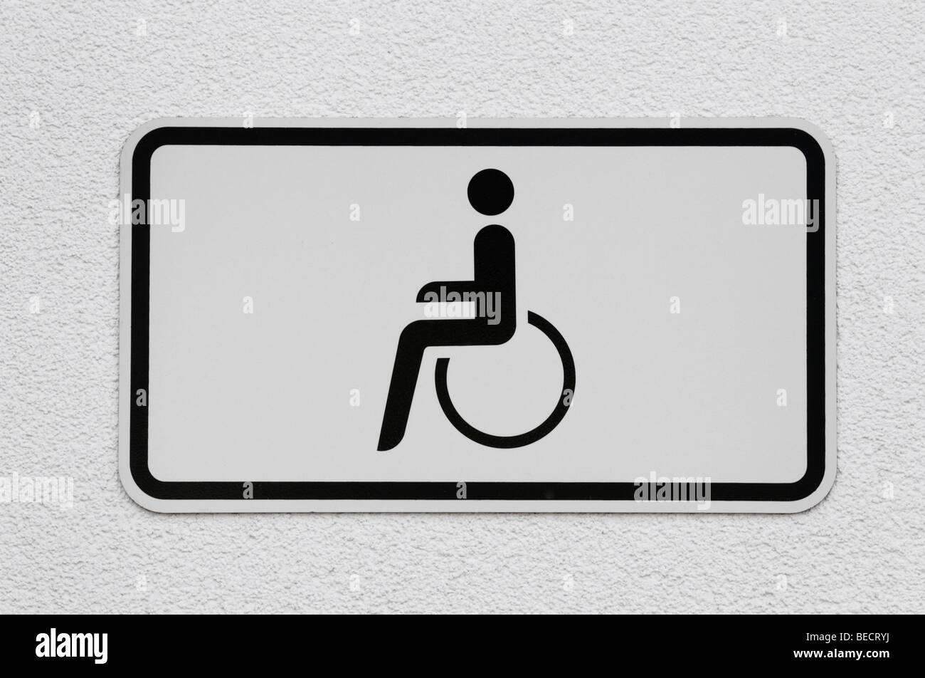 Pictogram: Person in wheelchair, reserved parking area - Stock Image