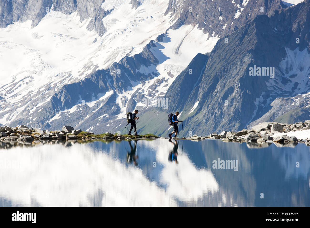 Hikers on the shore of the Friesenbergsee lake, Zillertal Alps, Northern Tyrol, Austria, Europe - Stock Image