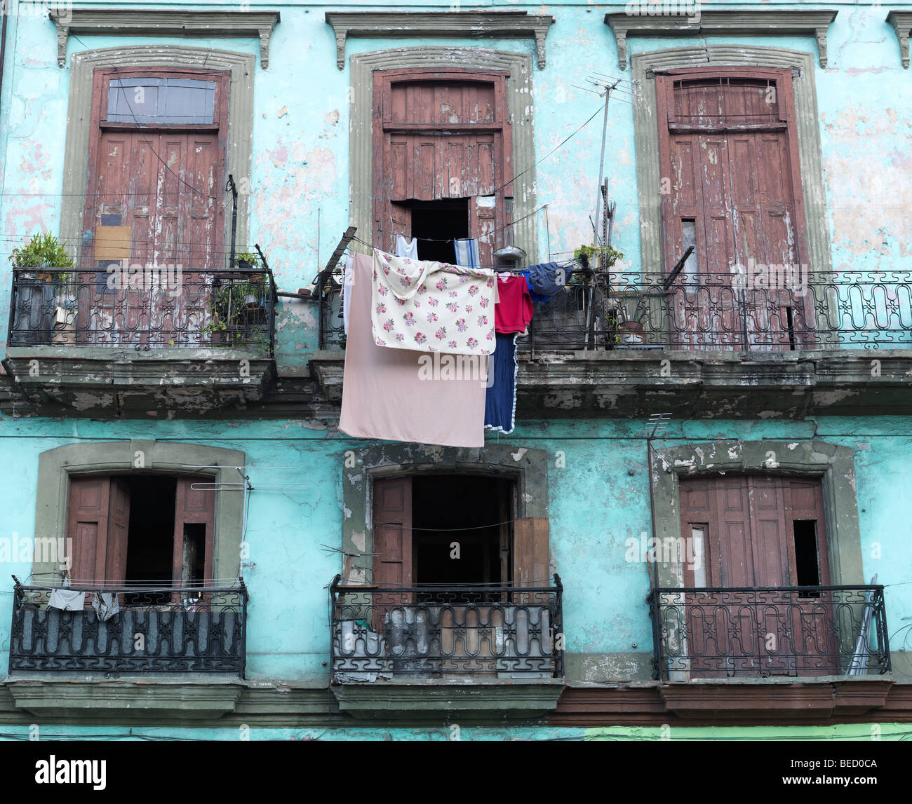 A green historic building house with balcony in the streets of Havanna, Cuba, pictured on March 1, 2009. Stock Photo