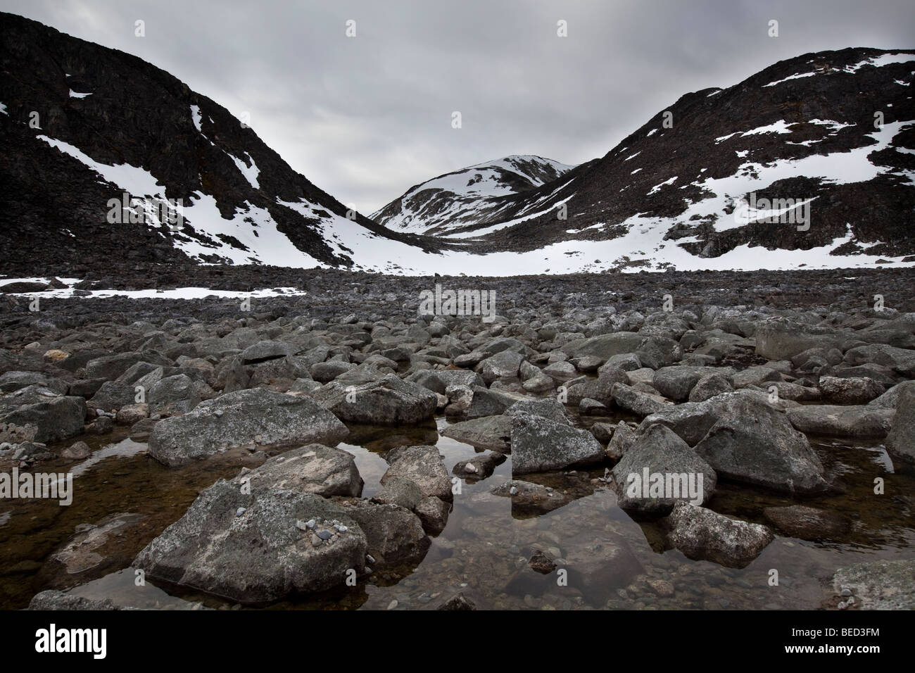 A rocky field at the mountain foot in Svalbard - Stock Image