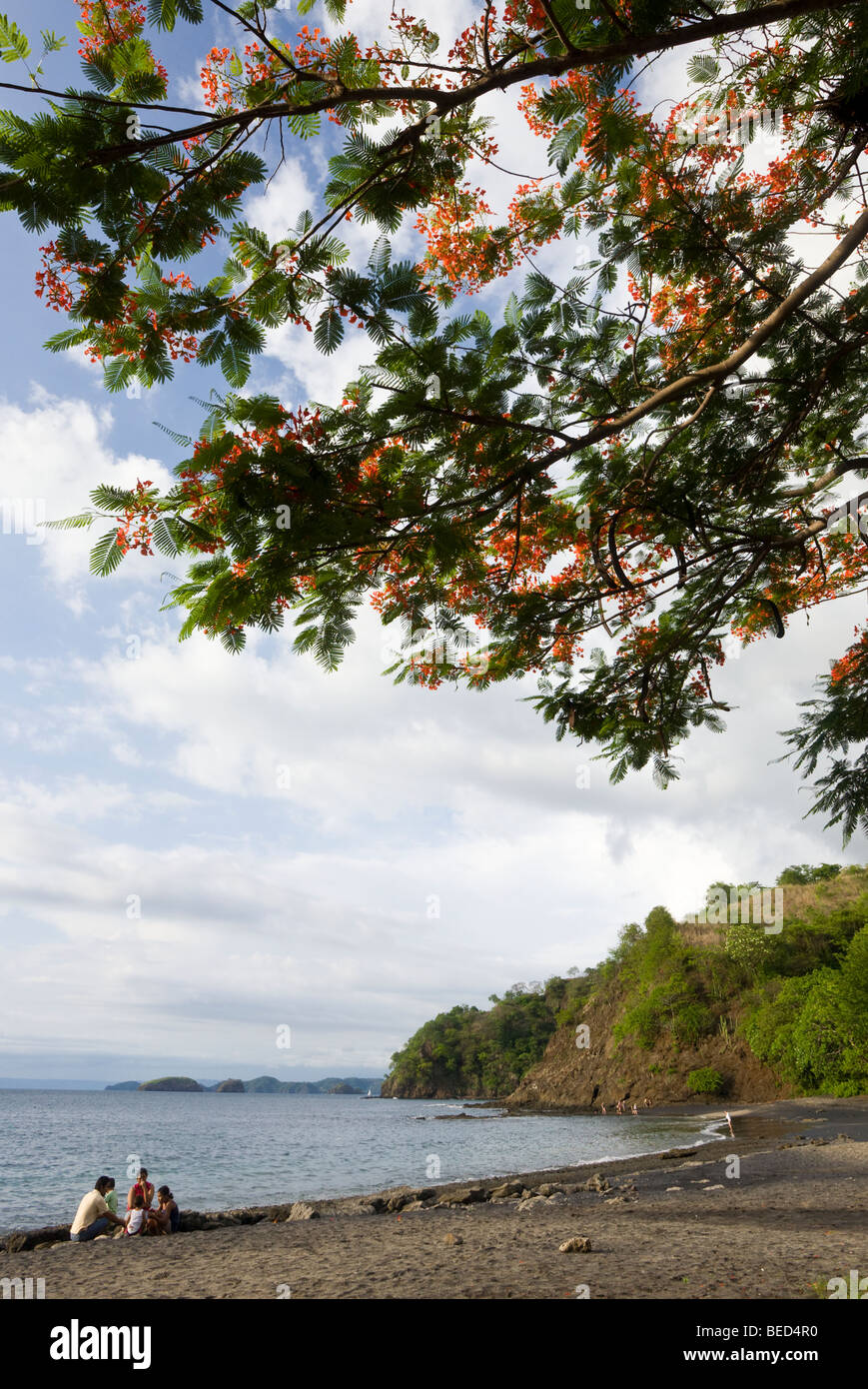 Costa Rican family picnicking along the quiet black sand beach of Playa Ocotal in the Guanacaste Province of Costa - Stock Image