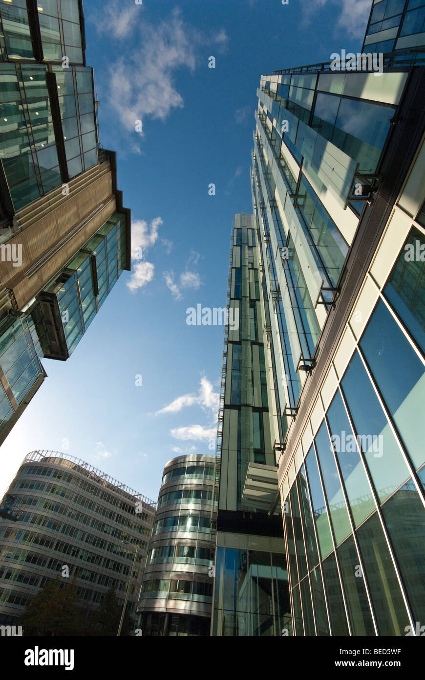 Manchester, UK: Looking up at buildings in the finance district at the heart of Manchester City Centre - Stock Image