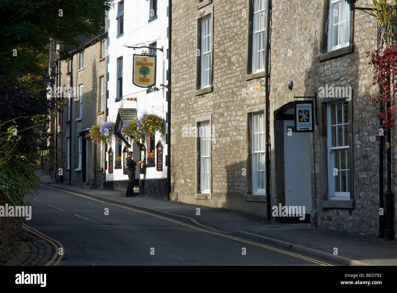 Man changing the menu outside the Orange Tree Hotel, Fairbank, Kirkby Lonsdale, Cumbria, England UK - Stock Image