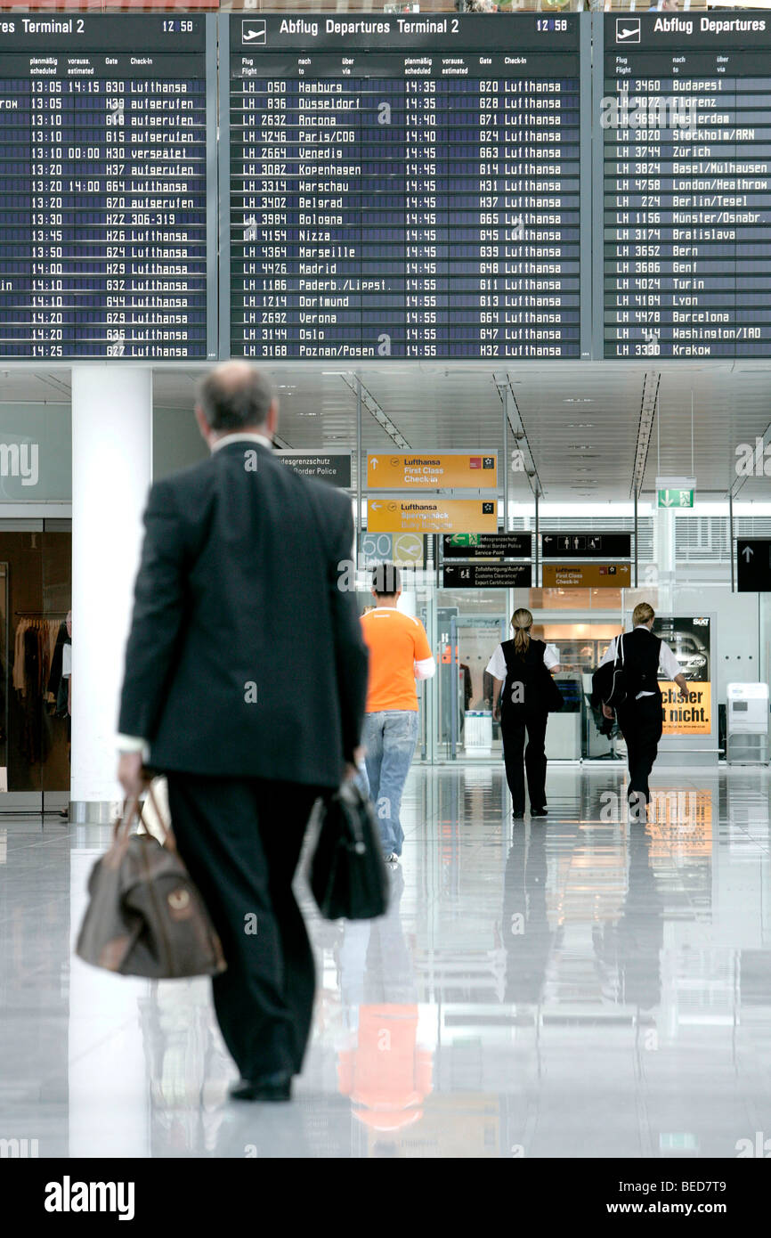 Passengers in front of the information board listing the departure times, Terminal 2 of Munich Airport, Franz-Josef Stock Photo