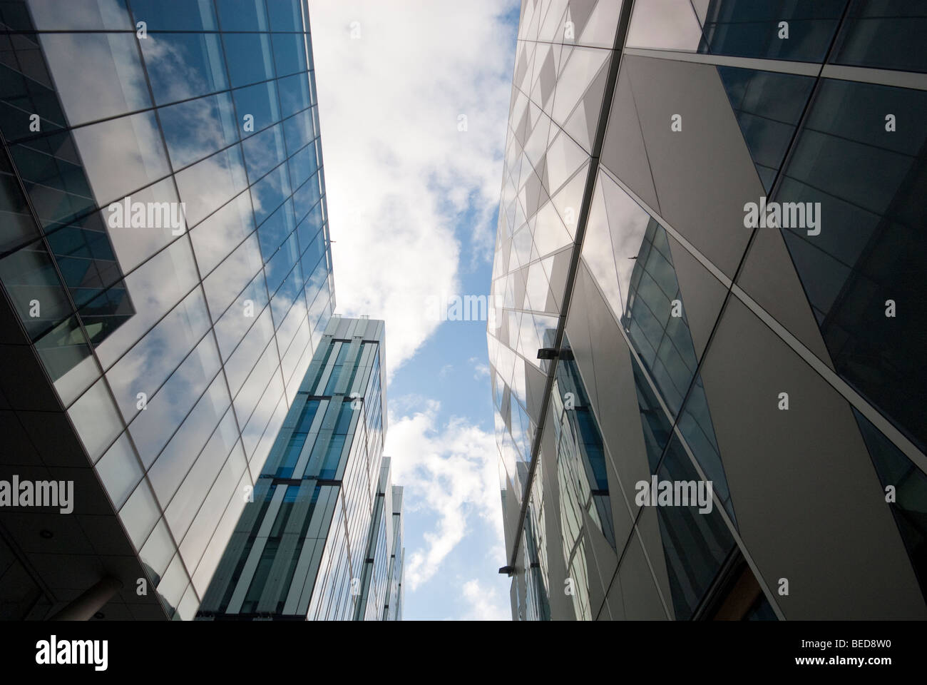 Manchester UK: Looking up at the finance district buildings at the heart of Manchester City Centre - Stock Image
