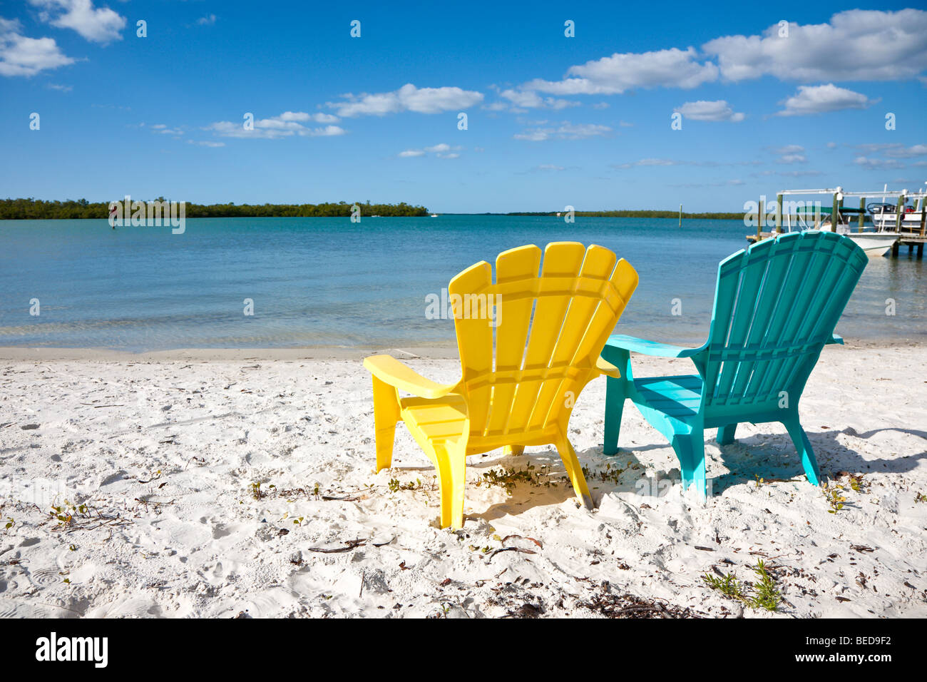 Attrayant Colorful Plastic U0027Adirondaku0027 Style Beach Chairs Face Into The Blue Ocean In  Naples,