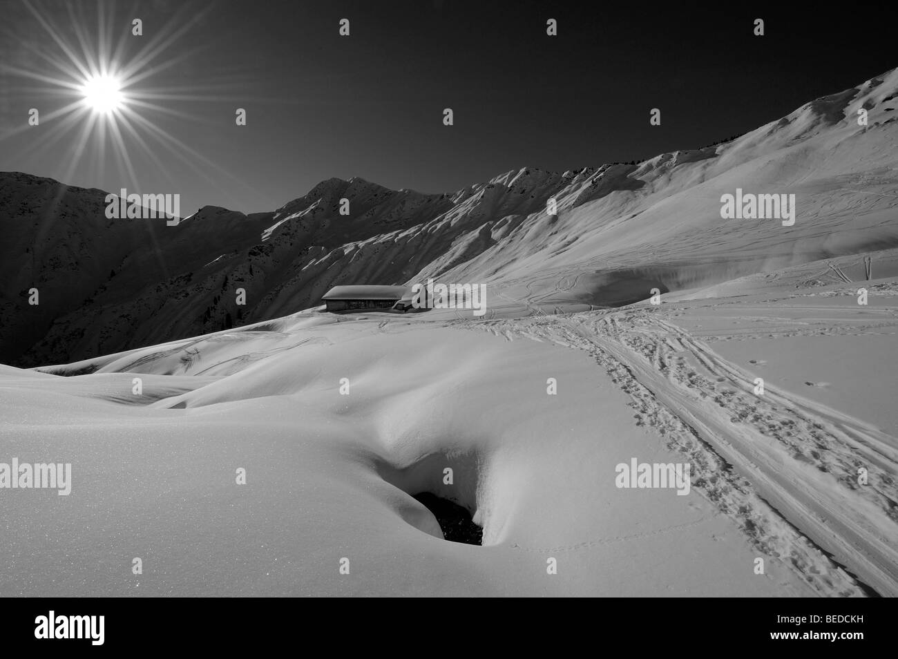 Skiing trail and alpine hut in snow-covered mountains, Mt Gruenhorn, Kleinwalsertal Valley, Austria, Europe - Stock Image
