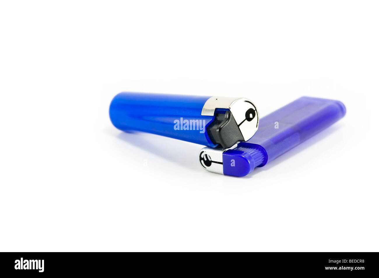 Two blue plastic lighters isolated on white - Stock Image