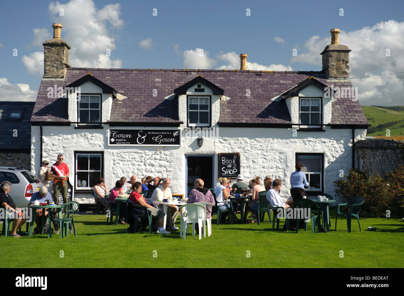 People sitting outside the Town and Gown tearooms and bookshop ...