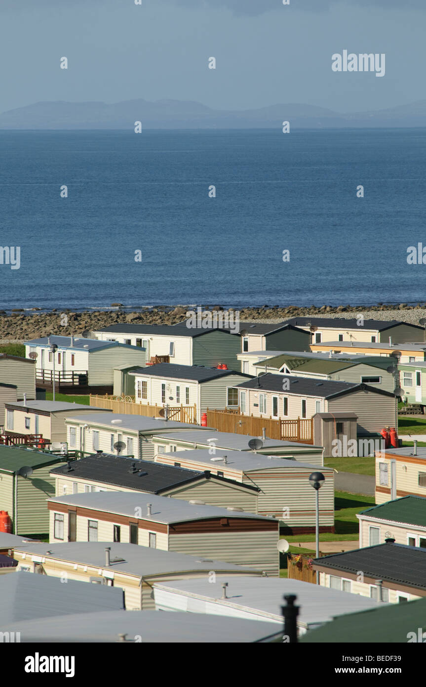 rows of static caravans parked in a Caravan park on the Cardigan Bay coast near Barmouth Gwynedd north wales UK Stock Photo