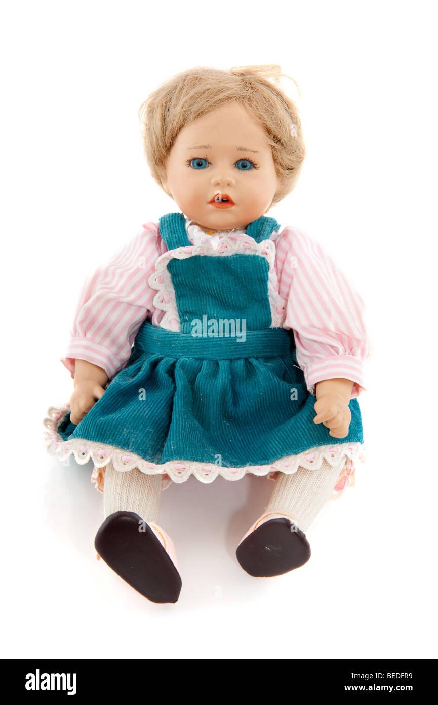 Little handmade girl doll with skirt isolated over white - Stock Image