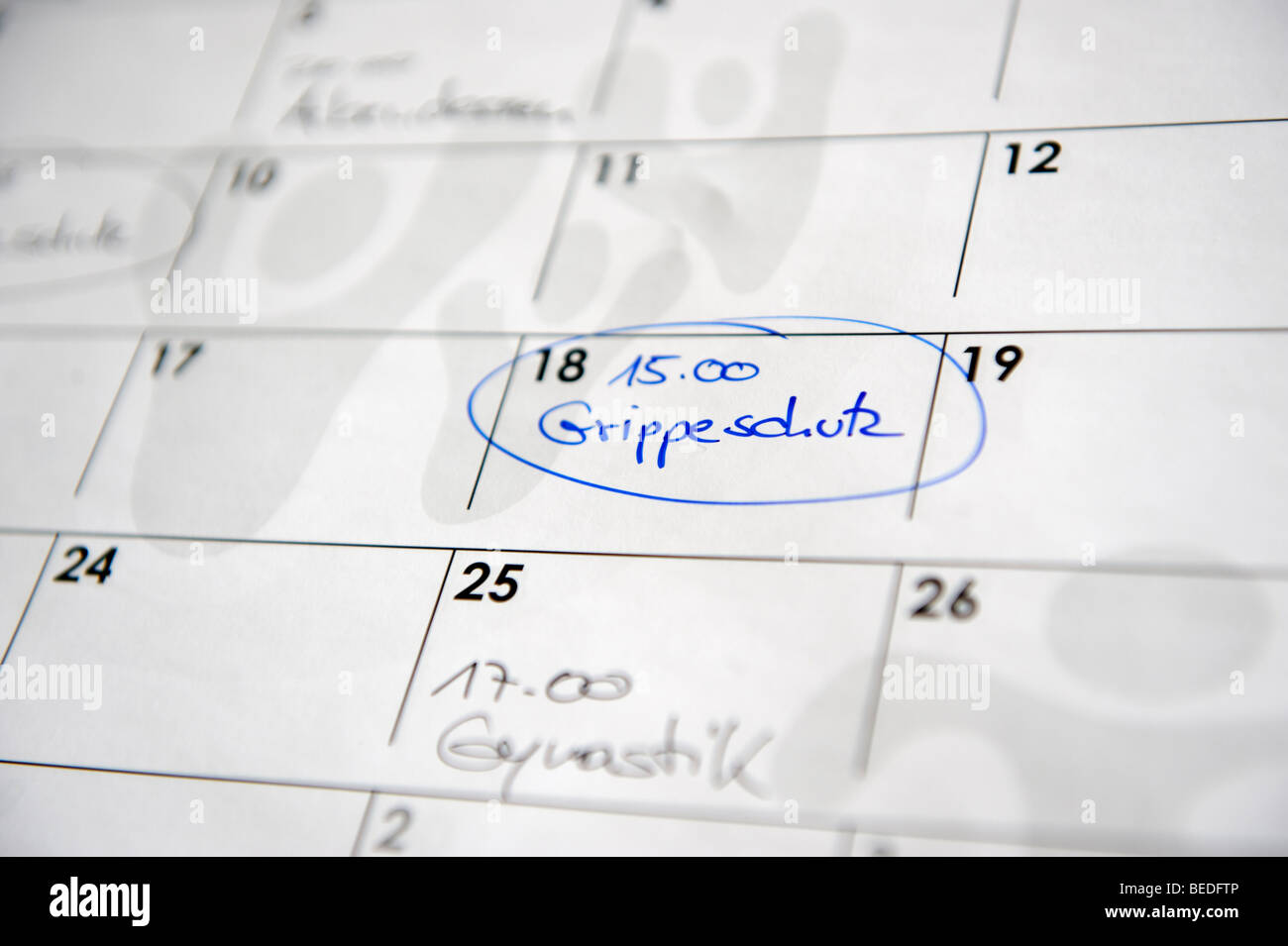 Calendar with an appointment for a flu shot - Stock Image