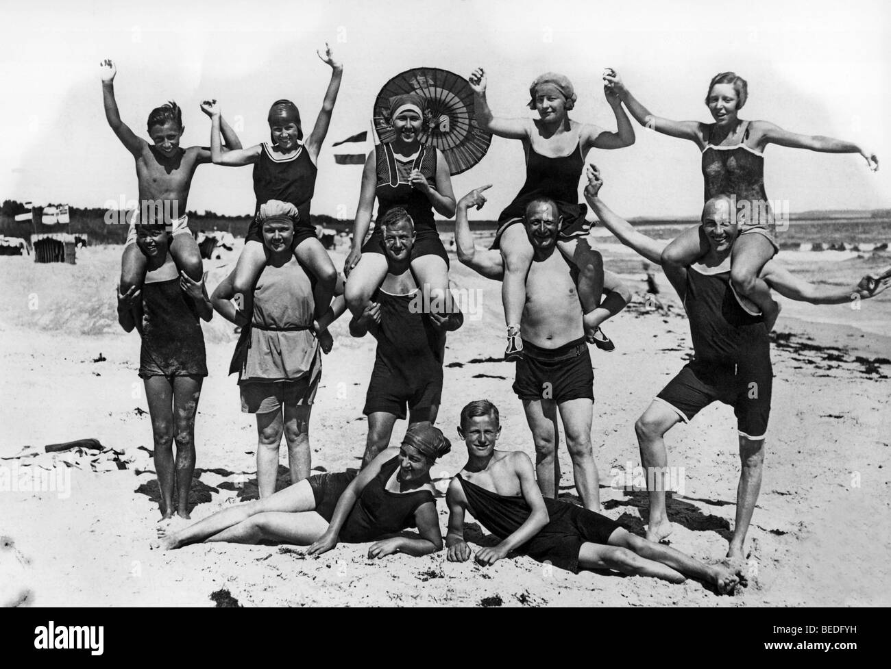 668202c1b24 Historic photograph, happy group of swimmers, Baltic Sea, around 1930 -  Stock Image