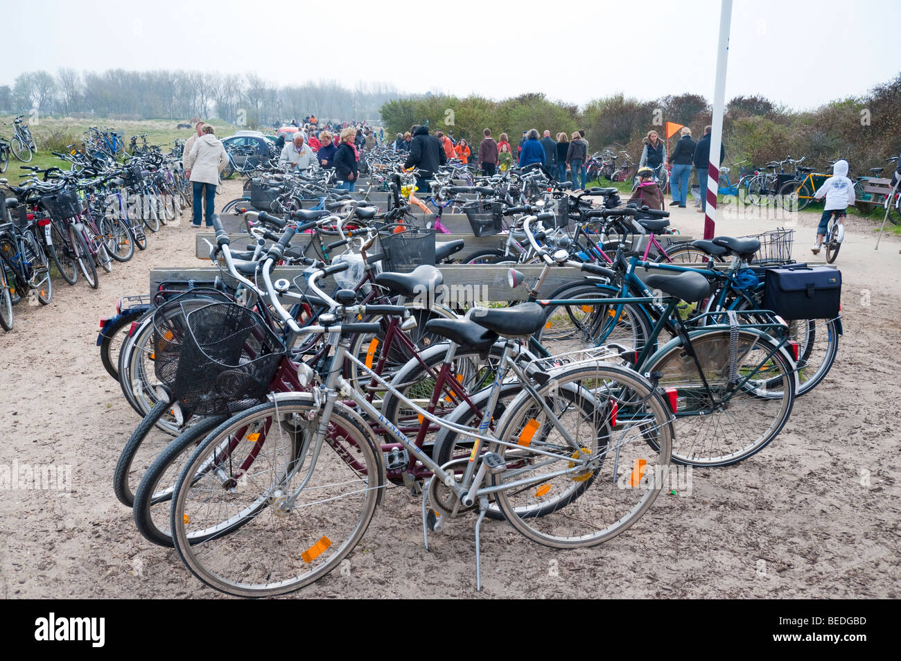 Bicycles stand close to the beach of the Dutch North Sea resort town of Renesse. - Stock Image