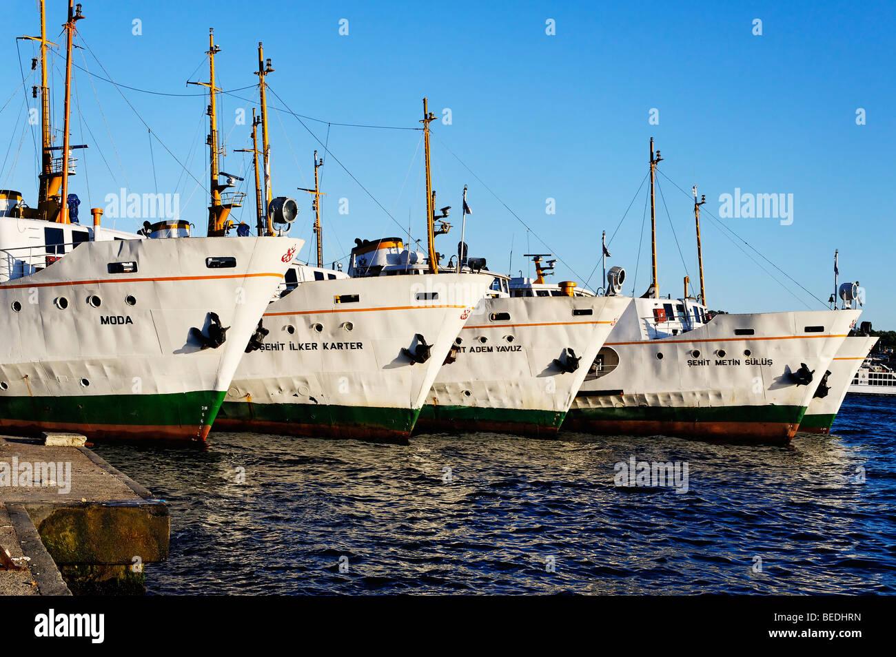 Bosphorus ferries moored on the dockside near Galata Bridge in the Beyoglu District of Istanbul. - Stock Image