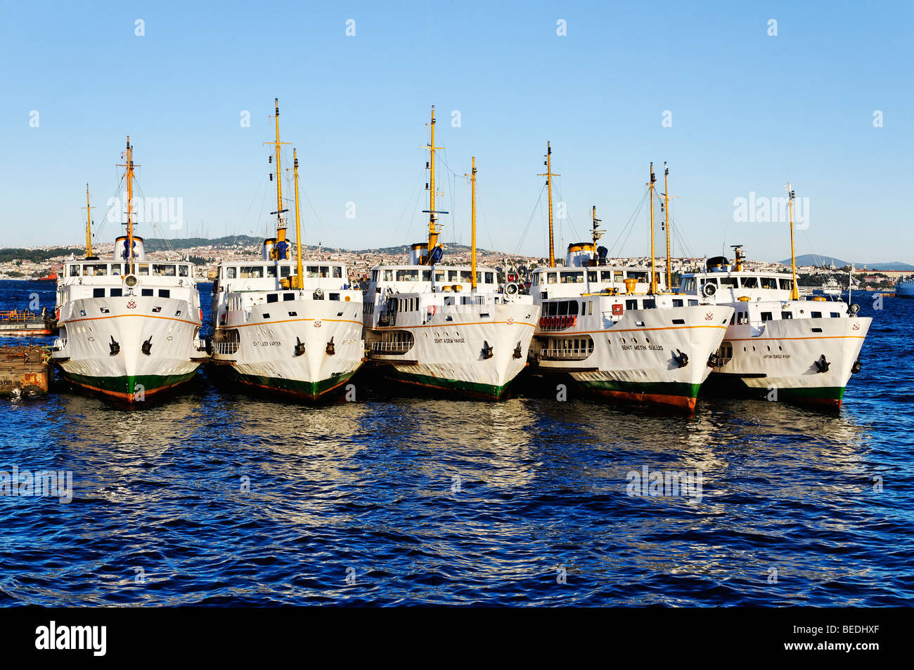 View from the Galata Bridge of Bosphorus ferries moored on the quayside in the Beyoglu District of Istanbul. - Stock Image