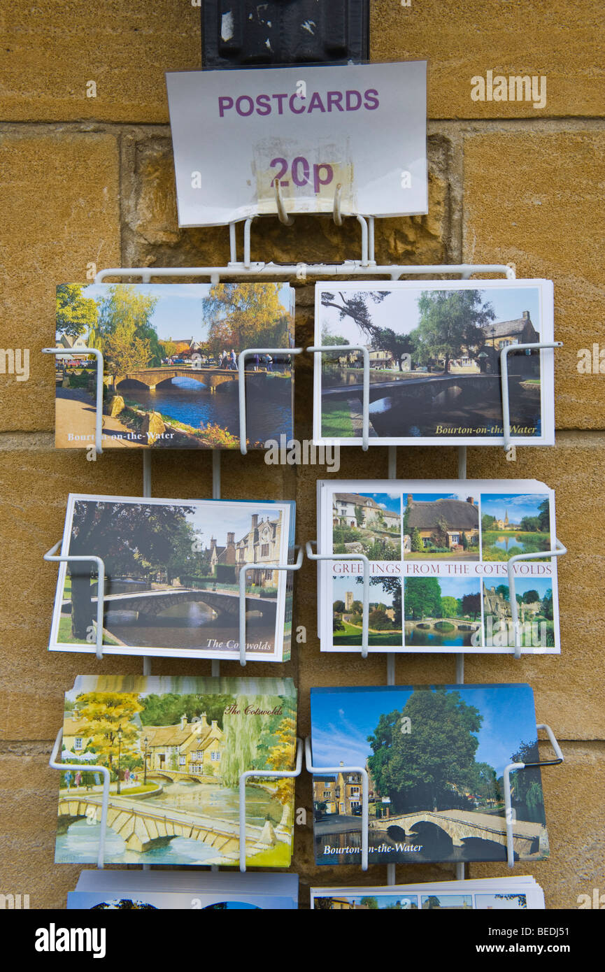 Tourist postcards in rack for sale in Cotswold village of Bourton on the Water Gloucestershire England UK - Stock Image