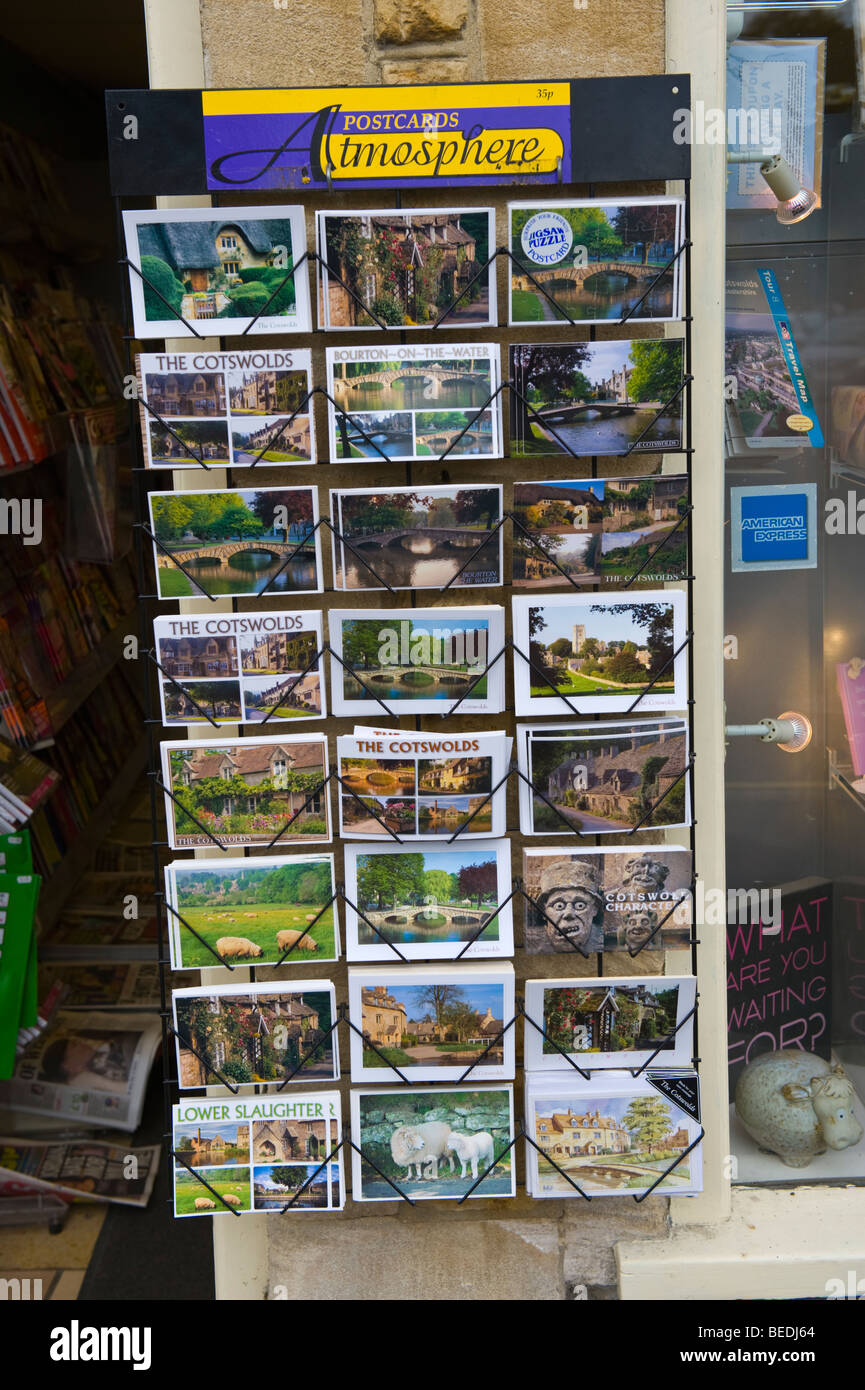 Atmosphere tourist postcards in rack for sale in Cotswold village of Bourton on the Water Gloucestershire England - Stock Image