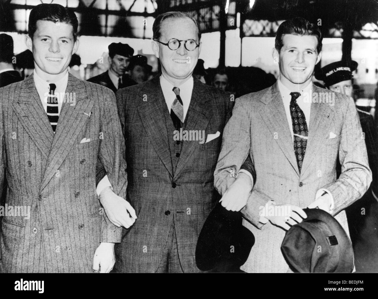 From left, John Kennedy, Joseph Kennedy Sr., Joseph Kennedy Jr. smile with linked arms. - Stock Image