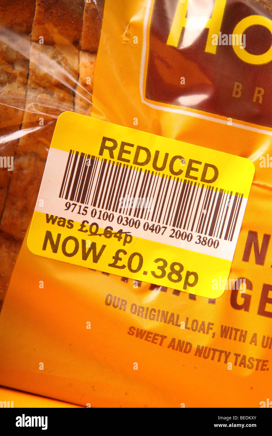 Supermarket reduced price food label sticker on a loaf of bread due to best before date expiry - Stock Image