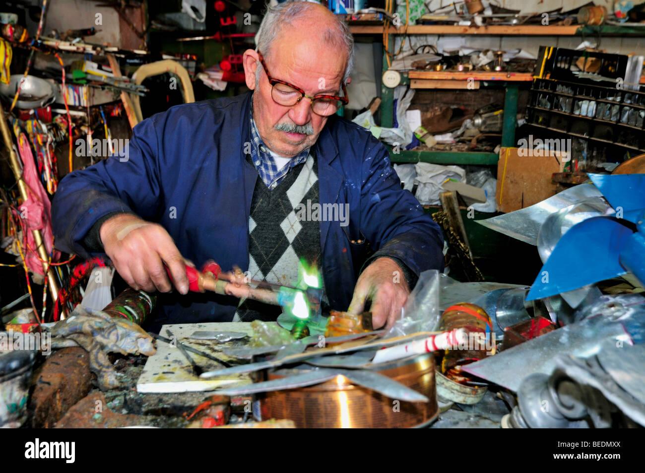 Portugal, Algarve: Mister Anibal da Silva Bandeira working in his metal atelier in Tavira Stock Photo