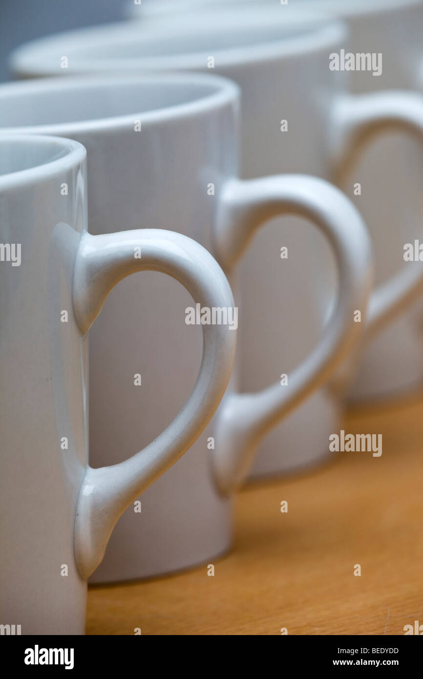 Mugs; white in a row - Stock Image