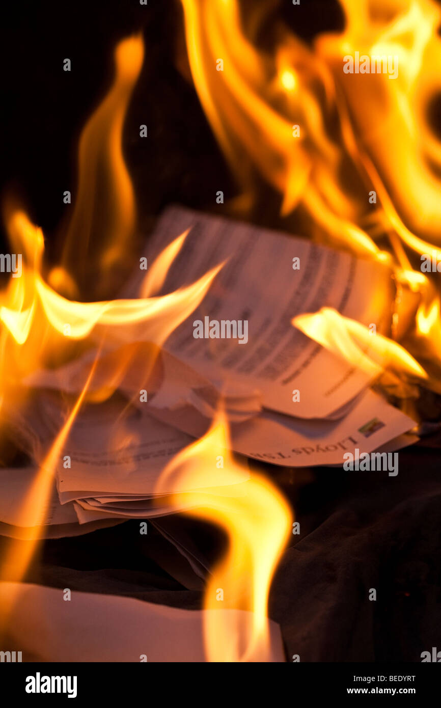 Burning Bank Statements during the Credit Crunch - Stock Image