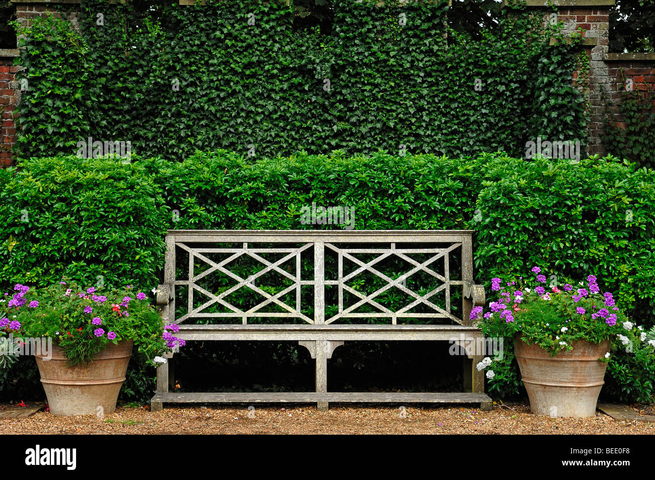Old garden bench with two flower buckets in the park of Walmer Stock ...