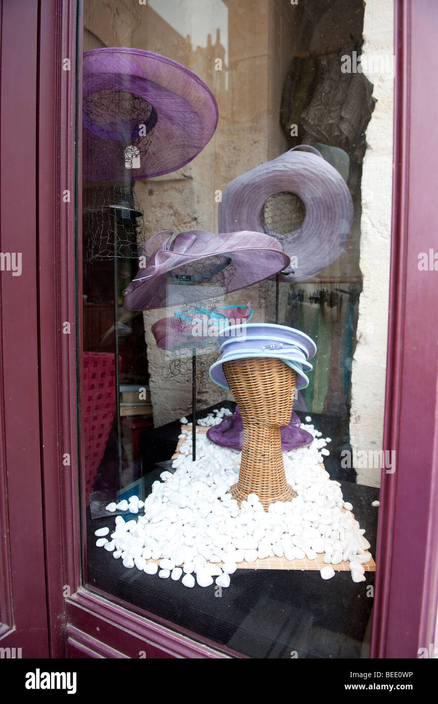 Reflections in a shop window of a hatter in Tours, France. Hat shop. Milliner. - Stock Image