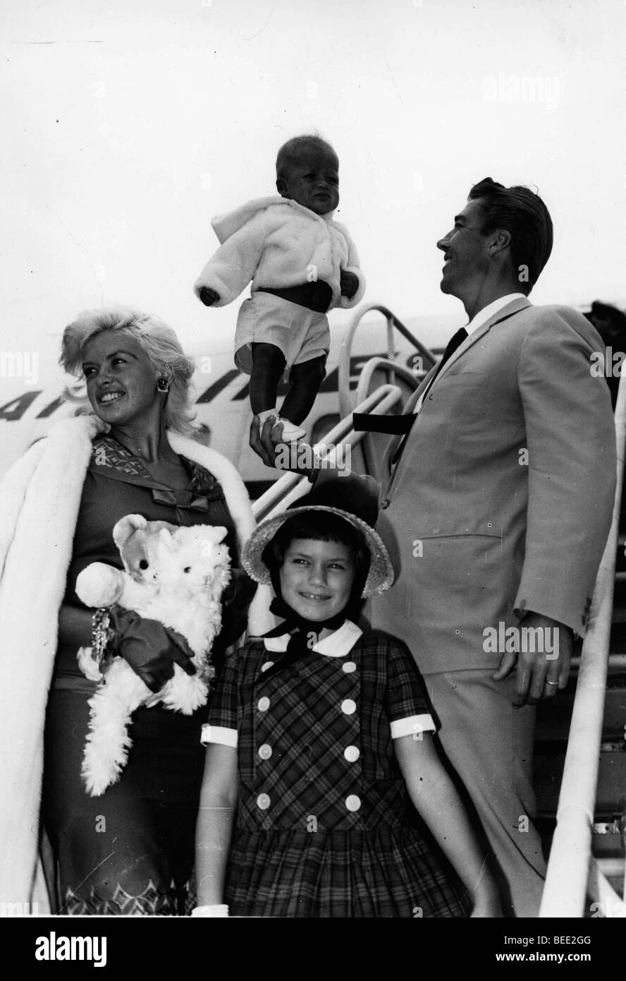 Actress Jayne Mansfield, her husband actor and bodybuilder Mickey Hargitay, with their children at an airport. Stock Photo
