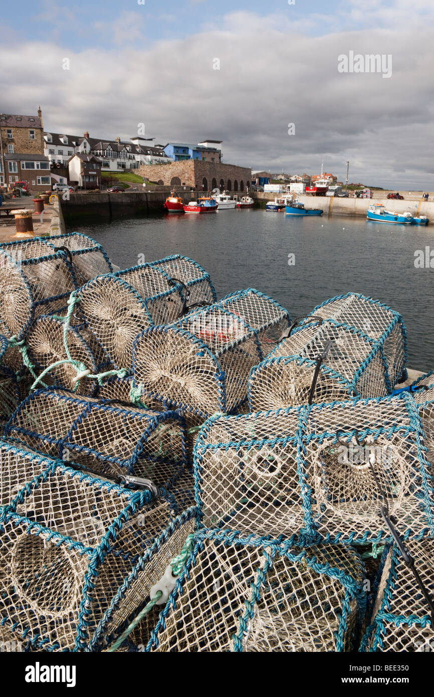 Lobster pots on the harbour wall in fishing village on the north east coast. Seahouses, Northumberland, England, - Stock Image