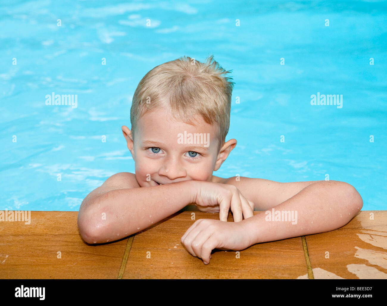 5-8888year-old boy in a swimming pool - Stock Image