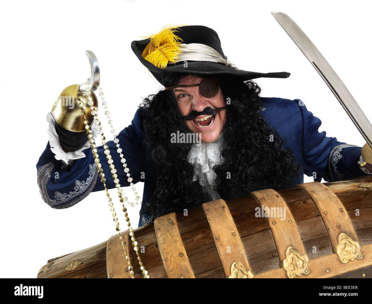 Laughing pirate opening a treasure chest - Stock Image