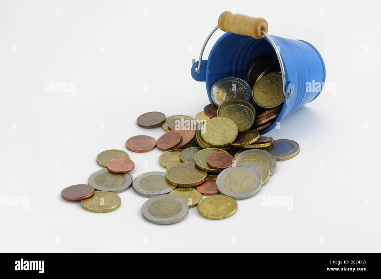 Small blue metal bucket with spilled Euro coins - Stock Image