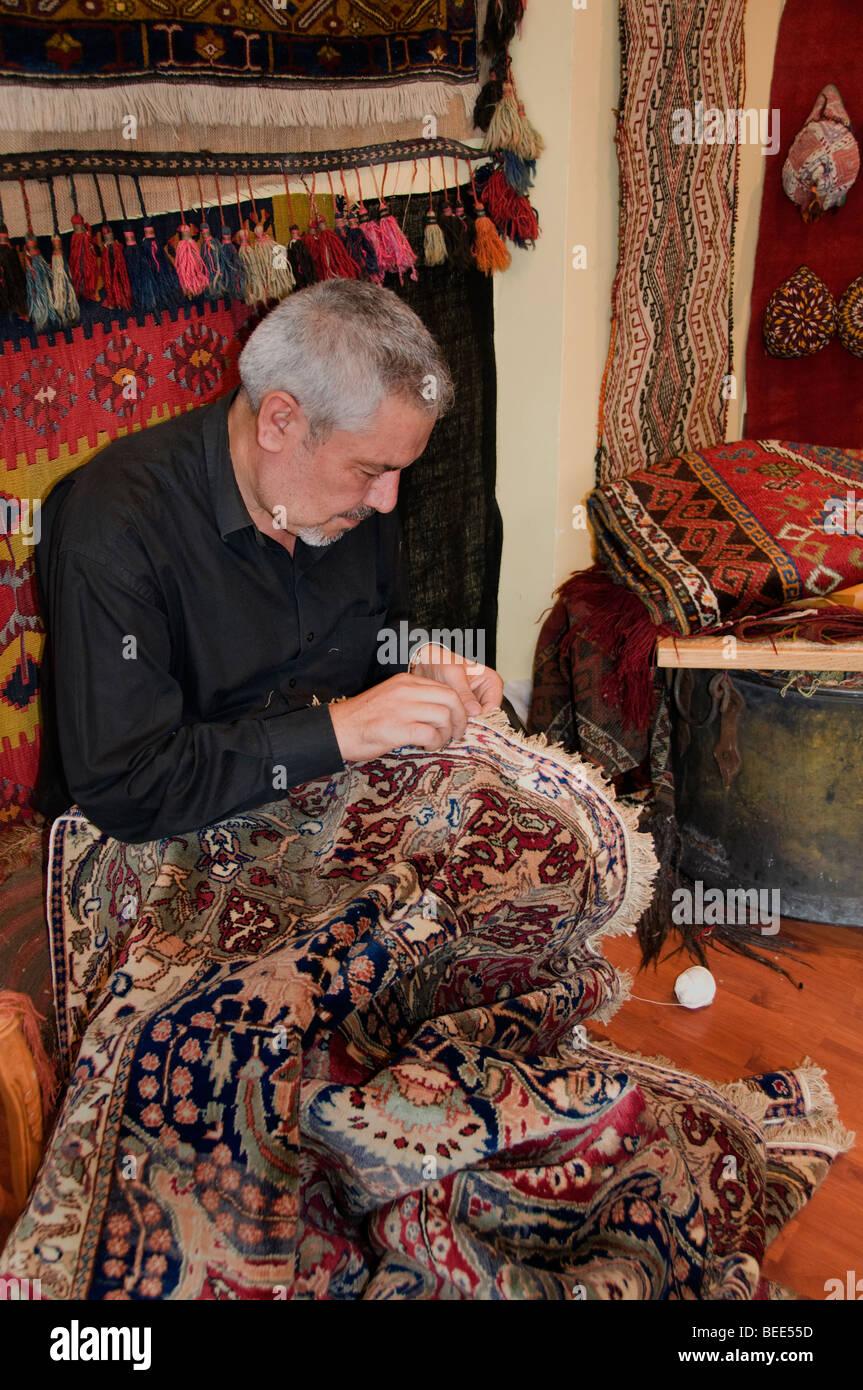 Istanbul Turkey carpets tapis carpet maker weaver weave weaving mill - Stock Image