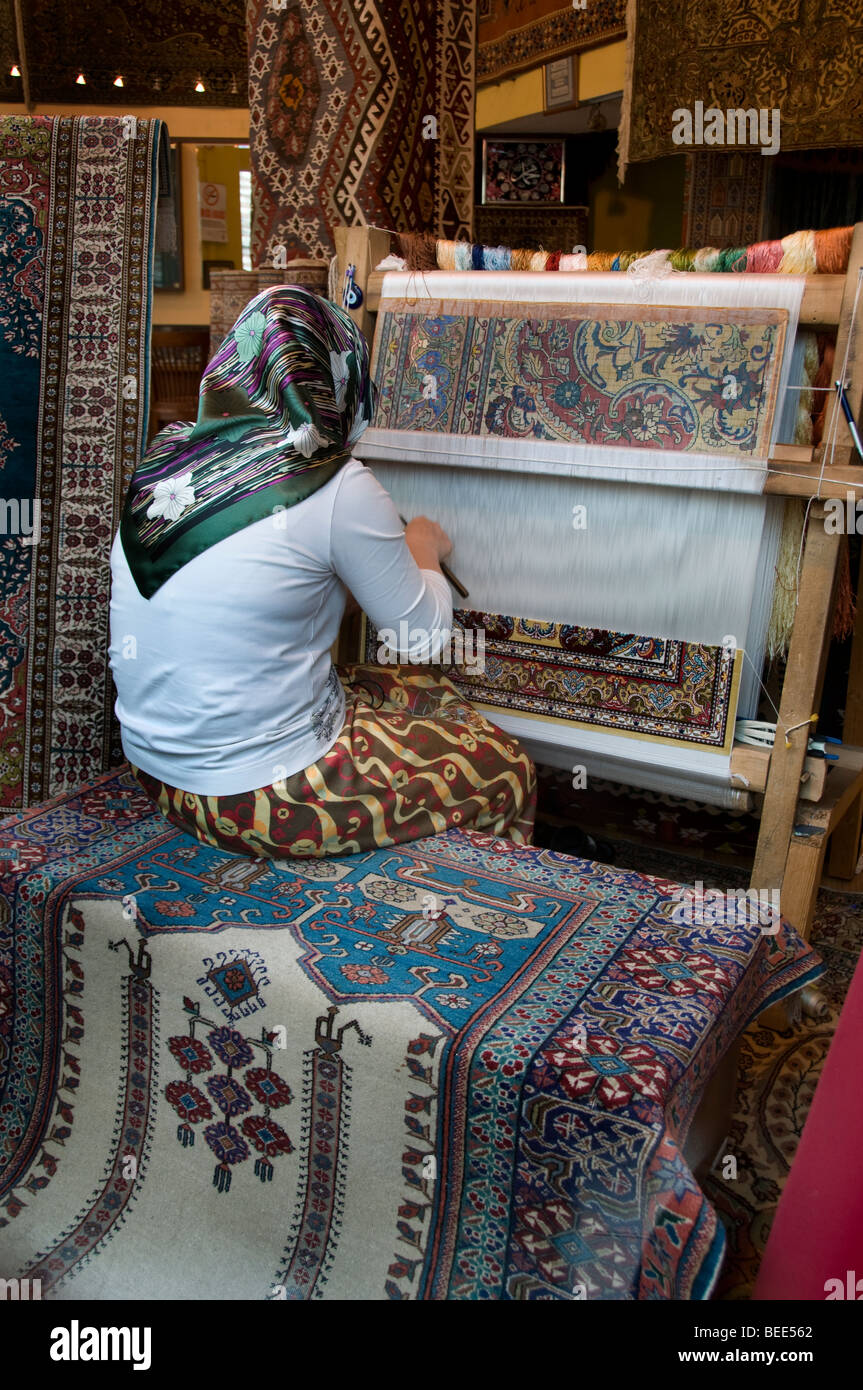 Istanbul Turkey carpets tapis carpet maker weaver weave weaving mill - Stock Image