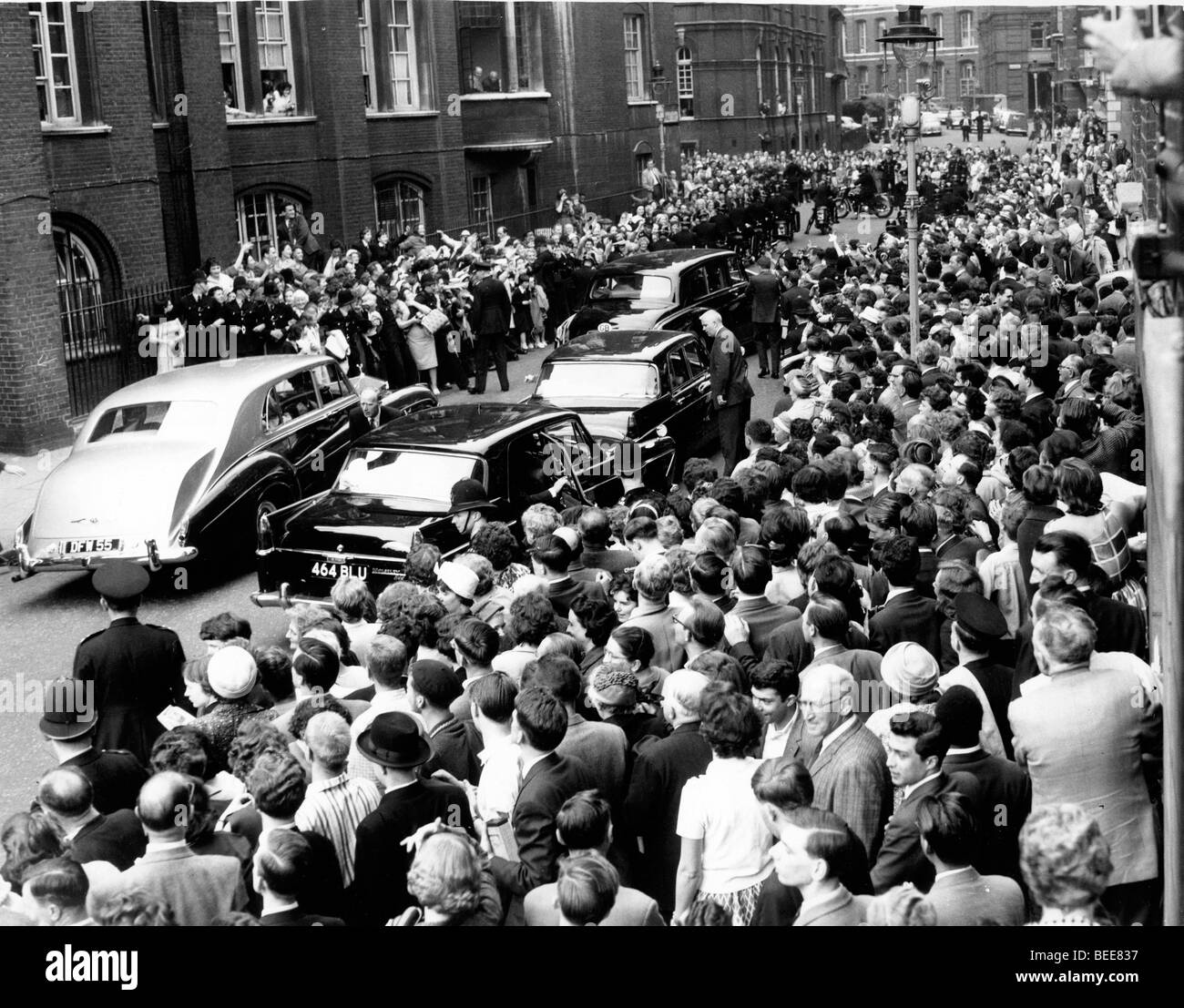 A crowd gathers to see US President John F Kennedy during a visit to London for the christening of his niece in Stock Photo