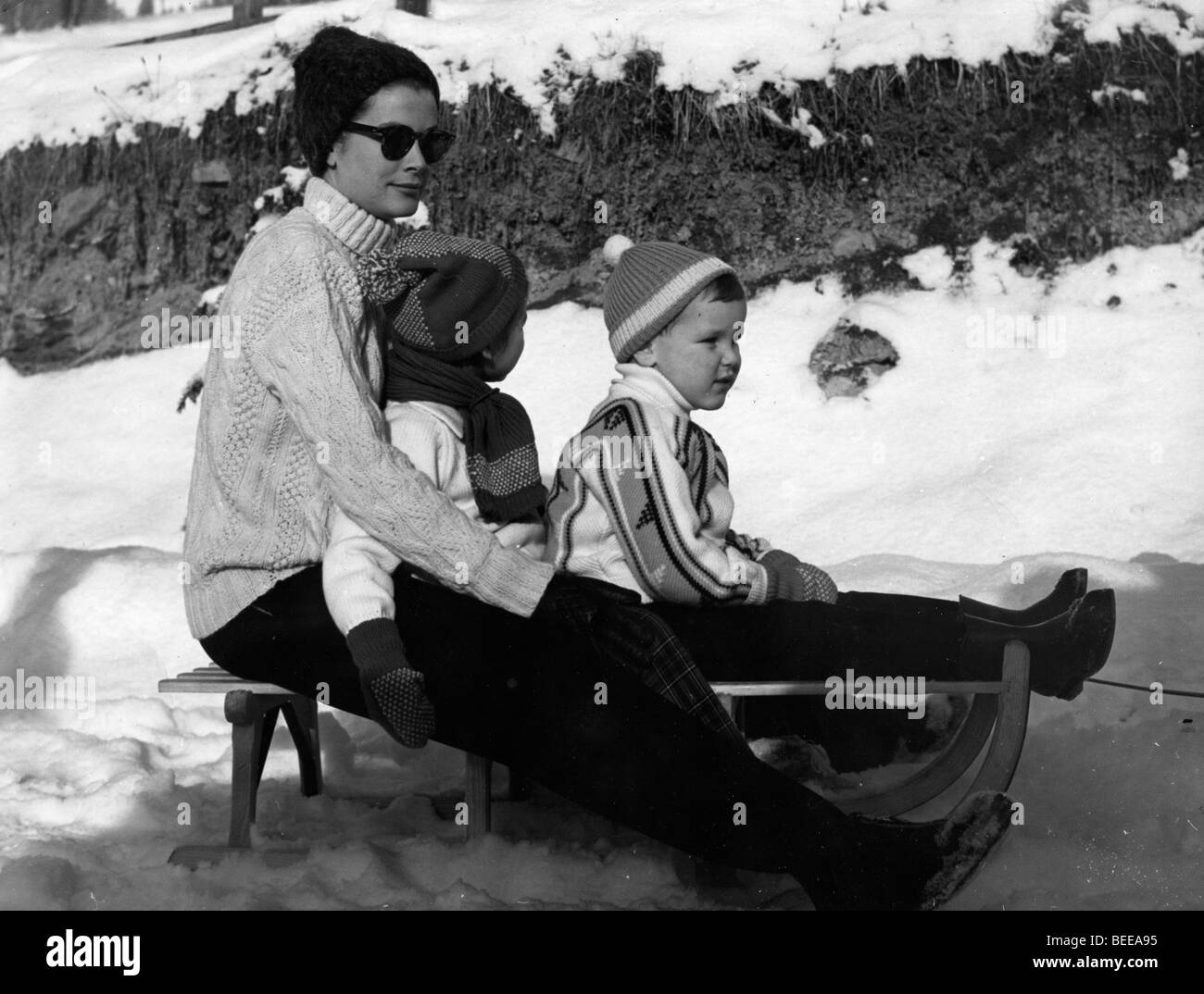 Grace Kelly sledding with her two youngest children, Albert and Stephanie. Stock Photo