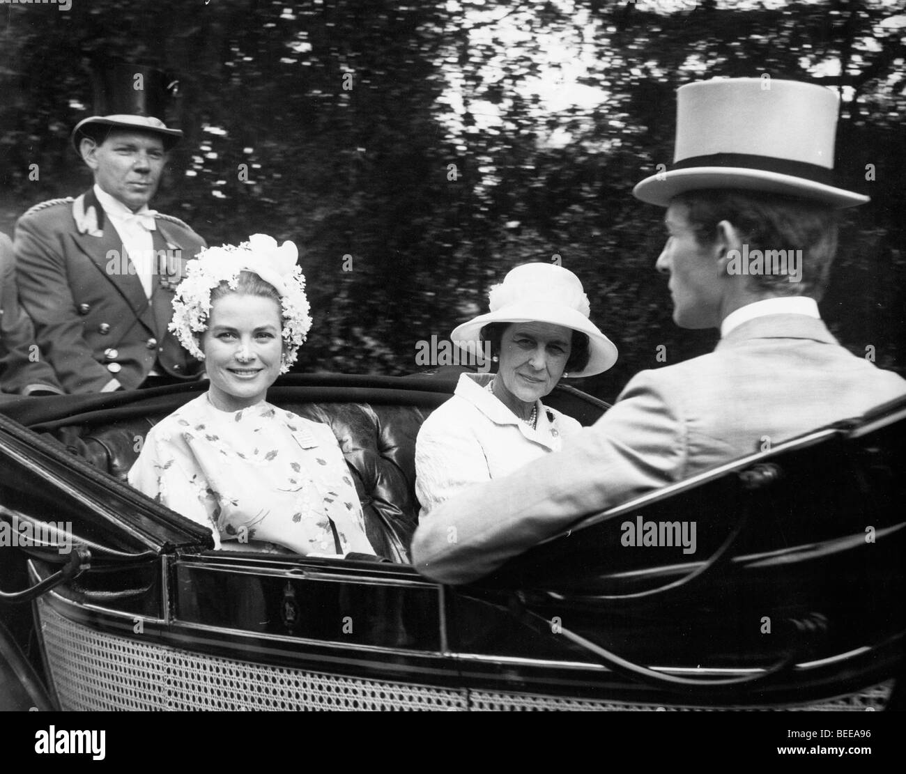 Grace Kelly, Princess of Monaco, left, in a horse drawn carriage. Stock Photo