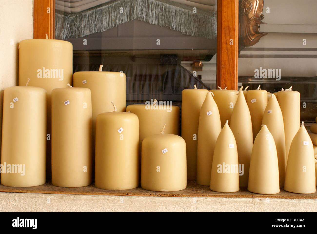 Beeswax candles for sale at a funeral parlour in San Miguel de Allende, Mexico - Stock Image