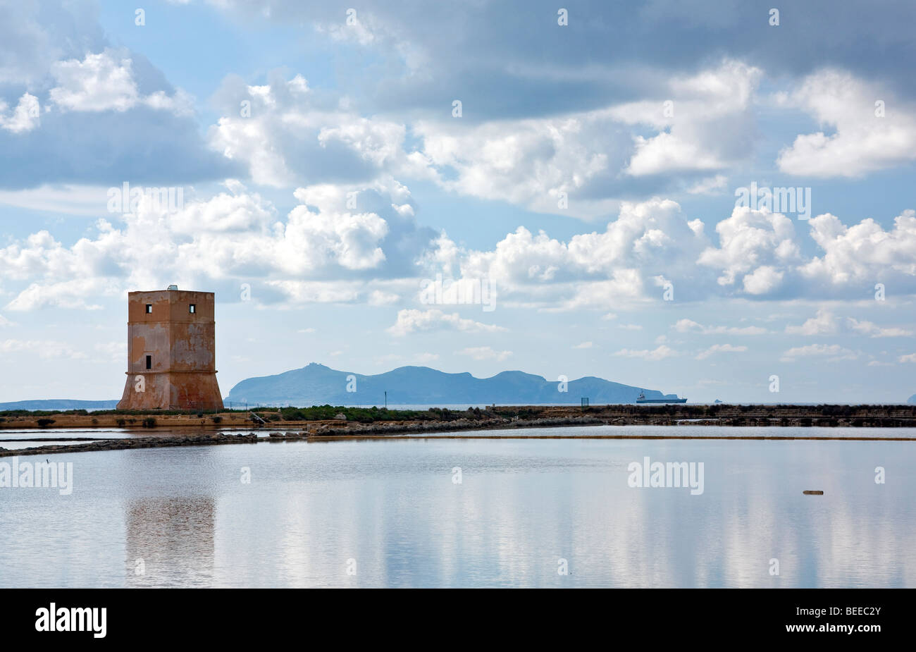 Saltwater basin and a guard tower, salines near Trapani, Sicily, Italy, Southern Europe - Stock Image