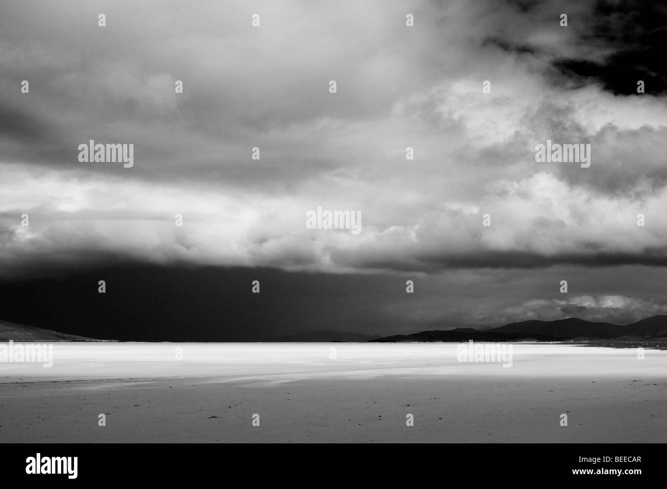 Rain storm and clouds over Traigh Scarista beach, Isle of Harris, Outer hebrides, Scotland. Black and White - Stock Image
