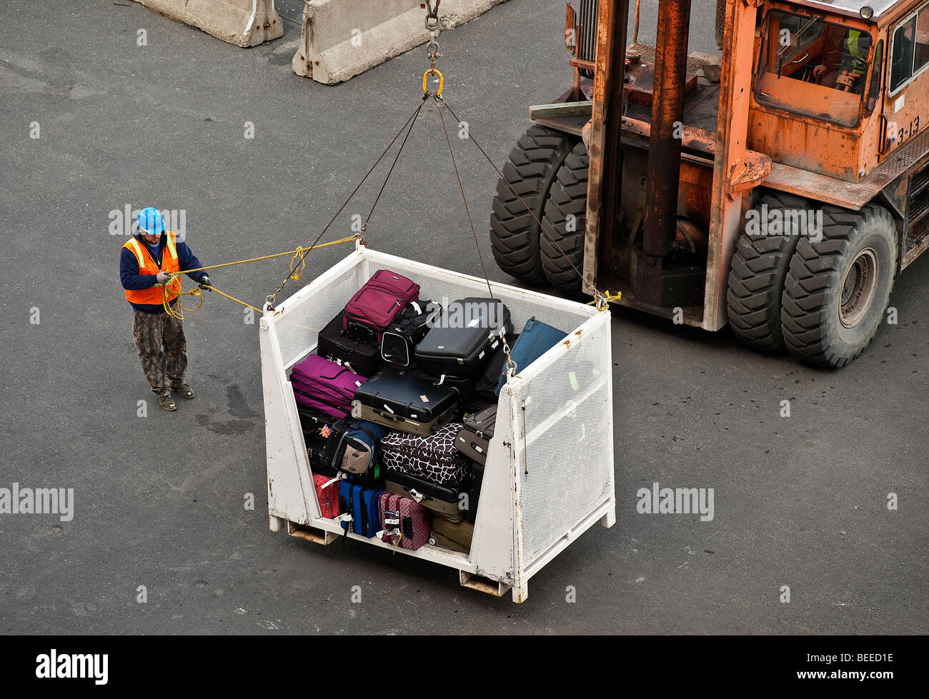Baggage being loaded onto a cruise ship. - Stock Image