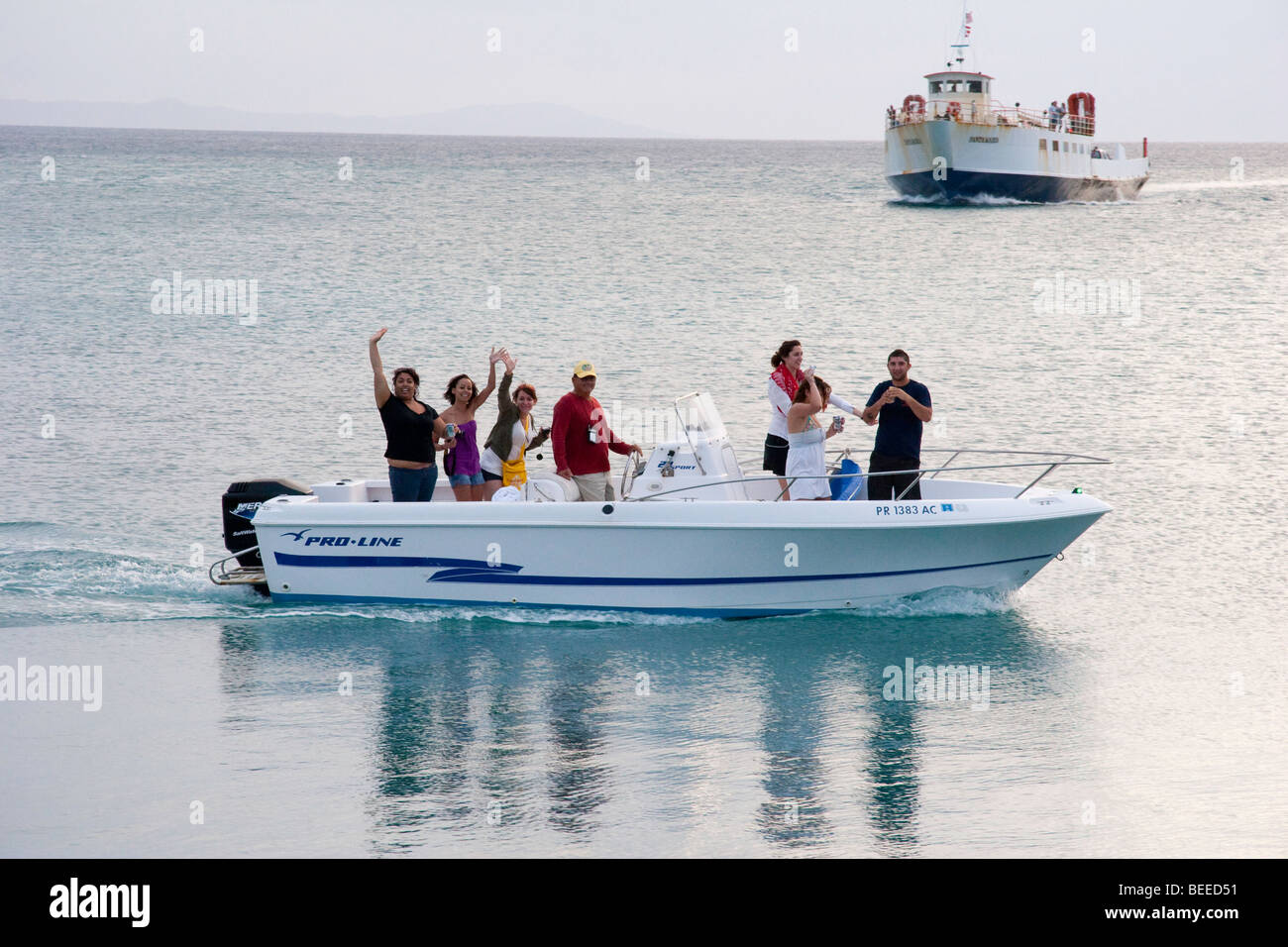happy boaters and the approaching ferry SANTA MARIA from the ferry landing in Dewey, Isla de Culebra, PR - Stock Image