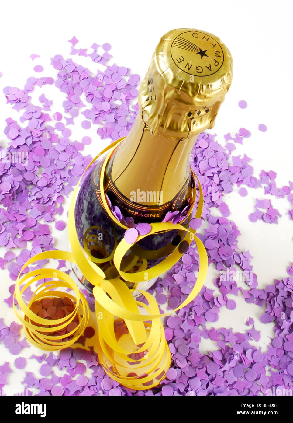 Champagne bottle with streamers and confetti - Stock Image