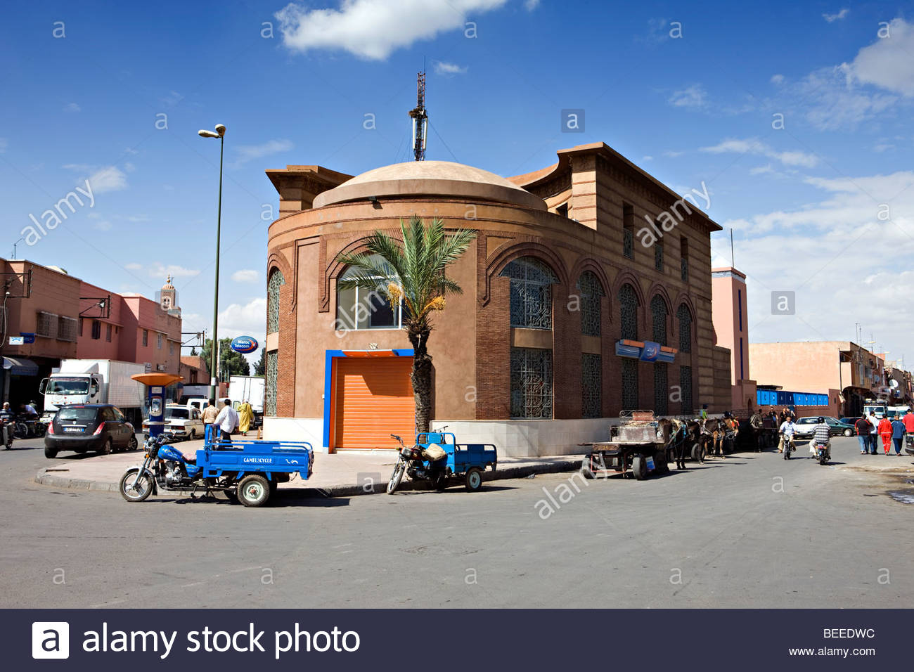 Marrakech street with tricycles and donkey carts - Stock Image